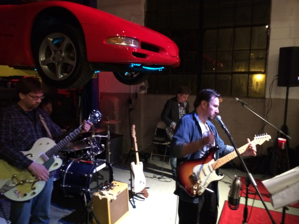 "Delco based rock and rollers ""The Relay's"" play under a red Corvette."